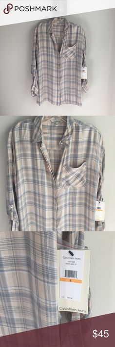 NWT Calvin Klein soft blush plaid button down NWT Calvin Klein button down plaid shirt. Very soft fabric. Blushing pale blue in color. Size S but has an oversized fit to it. Small snags in the shirt as pictured but barely noticeable. Cute slits in the side of the shirt. No trades. Calvin Klein Tops Button Down Shirts