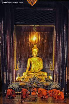 Monks praying inside Wat Pan Tao, Chiang Mai