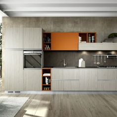 The elegant black of the Siemens ovens works perfectly with the orange highlights. Courtesy of Arredamenti Barba