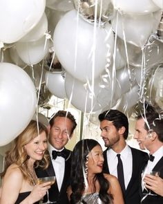 Hang balloons with lots of ribbons in the mix around the room...either use short ribbon and use ALL around the room, or long ribbon and use just in corners/sides of room. Colors: gold, pearl white, silver, pearl black My Tommy Hilfiger NYE