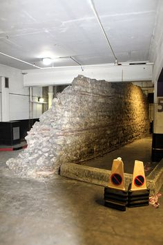 This section of London's old Roman Wall can be seen in the aptly named London Wall Car Park! London Wall, London History, The World's Greatest, Car Parking, Tour Guide, Roman, Tours, Explore, City