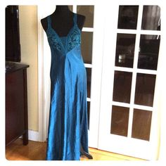 Victoria Secret Nightgown sz M In good condition absolutely gorgeous blue color. It has a front slit to one side with lace top and adjustable straps. fabric shown in pic. Victoria's Secret Intimates & Sleepwear
