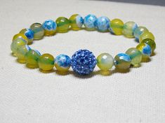 This Agate gemstone bracelet is made on stretch with no clasp. Easy to wear, just slip it on and go. I    •8mm Agate Gemstones •12mm Pave ball bead •Strong Stretch cord •St...
