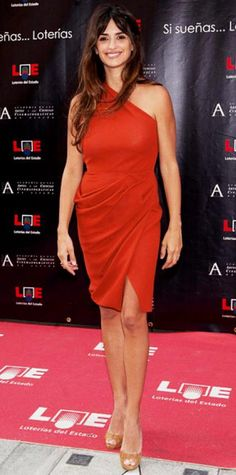 Look of the Day › June 28, 2011 WHAT SHE WORE Penelope Cruz got a star on Madrid's Walk of Fame in a draped Roksanda Ilincic dress and cork Louboutins. WHY WE LOVE IT Hot, hot, hot! The Spanish beauty kept it sexy and simple in a spicy red number.