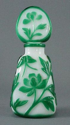 Chinese Cameo Glass Green Butterfly Perfume Bottle has an opaque white body with a green overlay of florals and butterfly with a floral stopper.