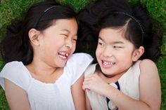 sisters on the grass, family & lifestyle photography, Sydney Northern Beaches portrait & lifestyle photographer
