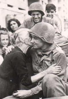 An Italian woman kissing a soldier of the 36th Texas Division.
