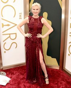 Ireland Baldwin wears a red lace gown by Burberry, shoes by Jimmy Choo and jewelry by H. Stern at the 2014 Oscars