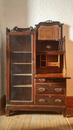 This is an Oak Secretary from the 1890's. It consists of four book shelves, a drop down desk, a drawer and a mirror. The piece has ornamental scroll work and beautiful trim. It has the original key that can be used to lock the bookcase, drawer and cabinet. This is a beautiful piece that would be a wonderful addition to any home or office.