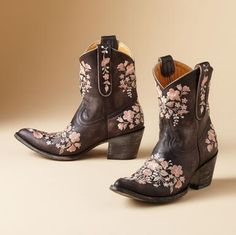 """Old Gringo boots are the real deal, handcrafted through and through with genuine dedication to traditional methods. Peach blossoms flourish on the distressed leather. Whitewashed 2-1/2"""" heel with nonskid rubber tap. Whole and half sizes 6 to 10, 11.View our entire Old Gringo Collection."""