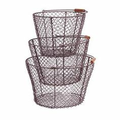 "Set of 3 openwork metal baskets with bail handles.  Product: Small, medium, and large basketConstruction Material: WireColor: BrownDimensions: Small: 7.5"" H x 10"" DiameterMedium: 8"" H x 11.5"" DiameterLarge: 8.25"" H x 13.25"" Diameter"