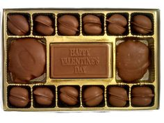 Enjoy delectable handmade chocolate with a Happy Valentine's Day chocolate candy bar greeting in the center.  On both sides are large milk chocolate Pandapaws (caramel pecan turtles) and surrounding the top and bottom are double dipped, milk chocolate covered pecans.
