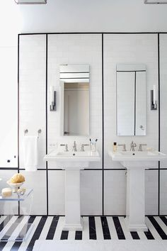 """ANN SACKS 3"""" x 6"""" Nero Marquina marble field and 9/16"""" x 8"""" box liner molding in honed finish with White Thassos 3"""" x 6"""" field in honed finish and KOHLER tresham pedestal and pinstripe pure faucet, Bancroft bathroom sink faucet and hand towel holder (location: Veranda show home in New York; designer: S. Russell Groves)"""
