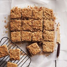 This delicious date squares recipe is a simple blend of brown sugar, oats, butter and sweet dates – a comforting treat for a cozy winter afternoon. Köstliche Desserts, Delicious Desserts, Dessert Recipes, Fruit Recipes, Healthy Desserts, Recipies, Baking Recipes, Cookie Recipes, Healthy Chocolate Muffins