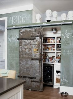 hide the storage with a very shabby sliding door. neat idea!