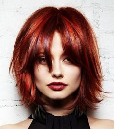 Short red bob with middle parting and long bangs