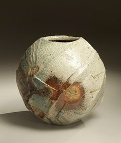 Nishihata Tadashi: Spherical Tanba vessel with faceted diagonal banding and dripping natural ash glaze and markings.