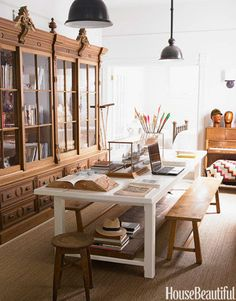Designer Myra Hoefer's California home's unique library and office features a large table perfect hosting dinner parties. I adore the cabinet- I would have something less utilitarian looking for the table though.