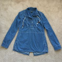 Eddie Bauer top sz med Super comfy and soft 100% cotton tunic top ! Looks like a jean material. Buttons up with drawstring closure at neck. Has pockets ! Eddie Bauer Tops