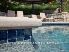 This stately San Francisco swimming pool uses American made Lightstreams Gold Iridescent Steel Blue glass pool tiles for the waterline tile, spa tile, and pool cover ledge tile. The rich silver blue creates an elegant finish in the pool's design. Glass Pool Tile, Blue Glass Tile, Pool Coping, Swimming Pool Tiles, Swimming Pools Backyard, Waterline Pool Tile, Florida Pool, Pool Remodel, Blue Pool