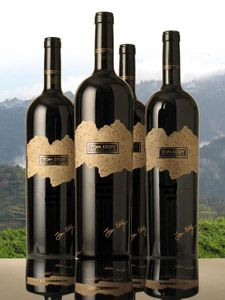Lot # 421  Tom Eddy Winery      Lot Description    4 bottles of Napa Valley wine, as noted  2 nights' accommodations for 1 couple  Harvest day for 2  Dinner for 2  Lunch for 2