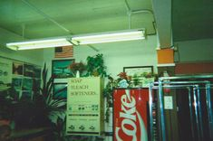 [a gas station in the town] Luz Artificial, Arcade, Estilo Tropical, It Goes On, Gas Station, Film Photography, Small Towns, Decoration, Scenery