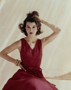 Anne Fogarty.  Model is wearing a red linen dress, with jewellry by Tiffany and Co.  June 1960