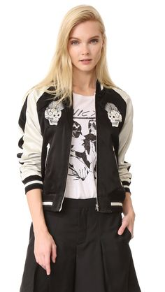 ¡Cómpralo ya!. R13 Reversible Punk Sukajan Bomber - Black & Ecru. A vintage inspired R13 satin bomber jacket with contrast raglan sleeves. Embroidered skulls and reinforced slash pockets detail the front. Zip placket and ribbed edges. Reversible. Lined. Fabric: Satin. Shell: 55% silk/45% cotton. Trim: 99% cotton/1% elastane. Dry clean. Imported, China. Measurements Length: 22.5in / 57cm, from shoulder Measurements from size S. Available sizes: M , chaquetabomber, bómber, bombers…