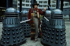 English actor Tom Baker in his role as the fourth incarnation of Doctor Who in the British science fiction television series of the same name. With him are two of his arch-enemies the Daleks in 1975 in London, England. Sci Fi Tv Series, Sci Fi Tv Shows, Baker Image, Classic Doctor Who, Arch Enemy, Dalek, Dr Who, New Movies, My Best Friend