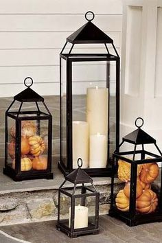Great use of lanterns to create an warn autumnal front entrance.