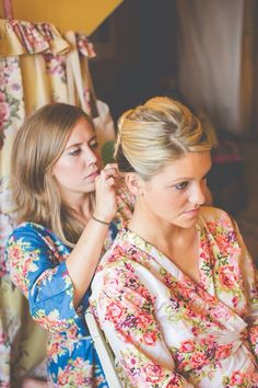 The maid of honor doing the bride's hair.