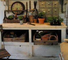 My potting table made out of an old bakery shop counter.