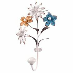 """Perfect for hanging keys by the door or an apron in your kitchen, this lovely wall hook showcases a floral design.  Product: Wall hookConstruction Material: MetalColor: White, blue, yellow and orangeFeatures:One hookFloral designDimensions: 9.75"""" H x 6"""" W x 3"""" D"""