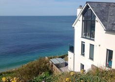 A welcome dinner is one of many treats in store at this big beautiful beachside house on the edge of the fishing village of Porthleven Fishing Villages, Big And Beautiful, Cornwall, Britain, England, Places, Holiday, Blue, Vacations