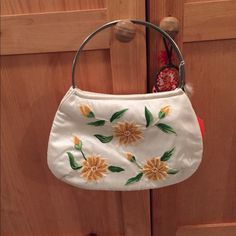 White vintage purse with yellow flowers White vintage purse with flower design: about 7.5 inches tall (without strap) and 11 inches long. Was given as a gift but likely from a vintage store because of slight wear as shown in last photo. Please ask all questions before purchasing. Please use offer button, thanks! USED Bags Mini Bags
