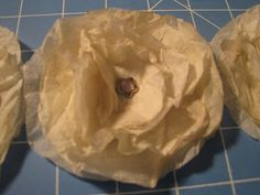lollipop flower gone shabby chic (just tissue paper, coffee, and a brad!)