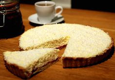 Manchester Tart. Pastry base, raspberry jam then custard layer all topped with desiccated coconut. Yum!