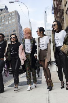 At NYFW, designers were not afraid to show their political statements. We've rounded up some inspo on how to wear the trend, and the best tees to shop now.