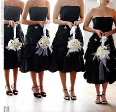 The bridesmaids wore lovely, black, tea-length dresses by DaVinci accented with rhinestone stars pinned at their waists. They carried white kissing balls of peonies and ranunculuses tied with white taffeta and sheer white ribbon.