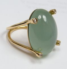 Jade cabochon and diamond ring in 18K gold.