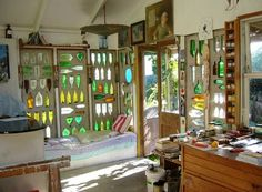 Wall panels with inset reused (melted) glass bottles for light and color.. Unmelted= insulation?