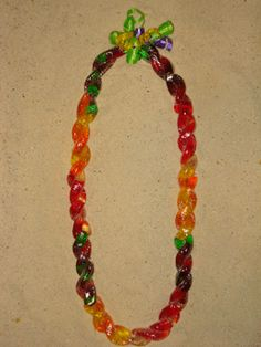 TWISTED GUMMY WORM CANDY LEI! Yet another kids favorite and perfect for birthdays as gifts and party favors.