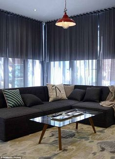 Charcoal sheer curtains over blinds. Both ceiling height.