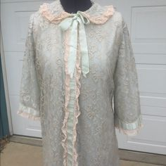 Lacy Vintage Robe Vintage light blue lingerie fabric overlayed with beige lace.  Snap closure.  Round collar with ribbon bow.  Very good used condition.  No tears, rips, stains visible Intimates & Sleepwear Robes