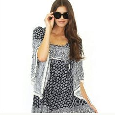 Free People Boho Heart Of Gold Mini Dress Free People Heart Of Gold Dress. Black and white. Drawstring under breast.  Unfinished edges. Adorable. Currently selling for $148 in stores. Price is firm. Free People Dresses Mini