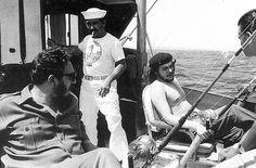 Fidel Castro, Che Guevara, and Alberto Korda fishing off the coast of Havana, 15 May 1960.
