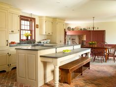 Farmhouse Kitchen by Timeless Kitchen Cabinetry, a half table attaches to the island for additional seating- I like this idea, and the Soapstone counters