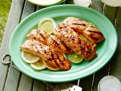 Triple-Citrus-Glazed Grilled Salmon : The Neelys lend a brightness to grilled salmon by brushing it with their triple-citrus glaze during and after grilling. Gina recommends using chicken stock in the citrus glaze to round out the flavors.