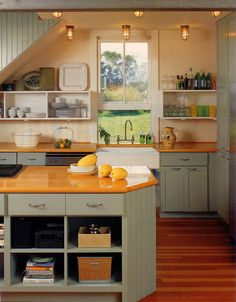 common theme with open shelving seems to be to keep the shelving and cabinets as monochromatic as possible, letting the items on the shelves be the pop of color