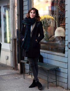 Alexa Chung: pinstripe top, tan cardigan, dark peacoat, pants and shoes, patterned scarf